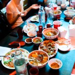 Doing some damage at the communal dining table of Mission Chinese Food NYC.