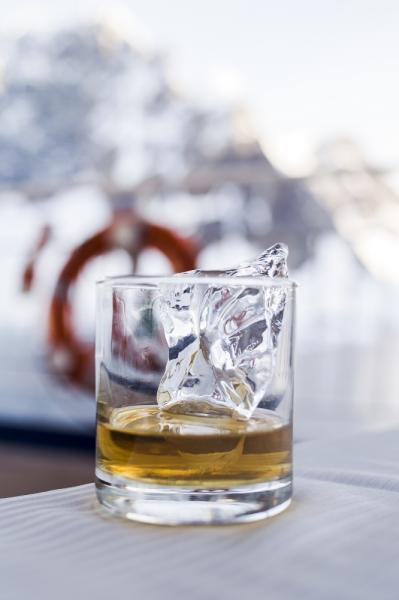 Glaciar ice - said to be ten thousand years old - reborn as an ice cube for a glass of whiskey in Antarctica.