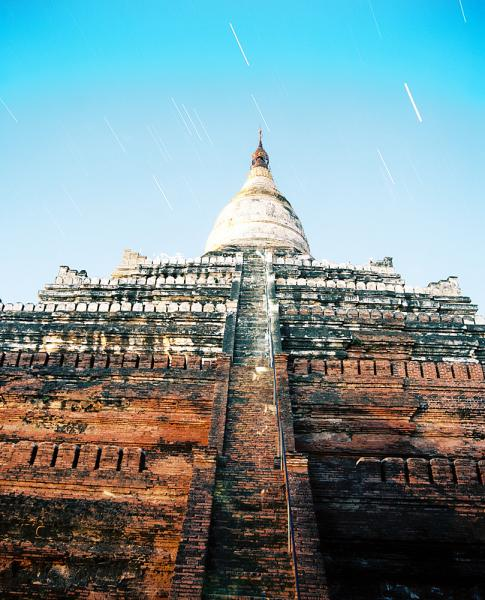 The Shwesandaw Paya (Pagoda) in Bagan, Myanmar is one of the most popular pagodas from which to watch the sun set. The enterprising traveler will instead venture up the pagoda at sunrise and thus miss all of the late afternoon crowds and bus traffic.