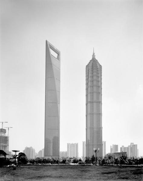 The Shanghai World Financial Center rises from the Lujiazui financial district of Pudong, in Shanghai. Also known as the Mori Building, after the Japanese development company that is building it, the bottle-opener-shaped structure rises 101-stories (492m) and will house the Park Hyatt hotel.