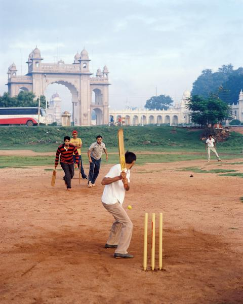 Playing some early morning cricket outside the Mysore Palace in Karnataka Province, India.