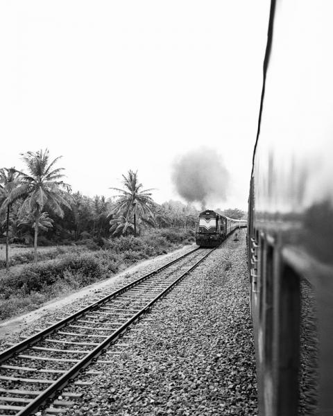 A locomotive approaching the Golden Chariot Train in Karnataka Province, India.