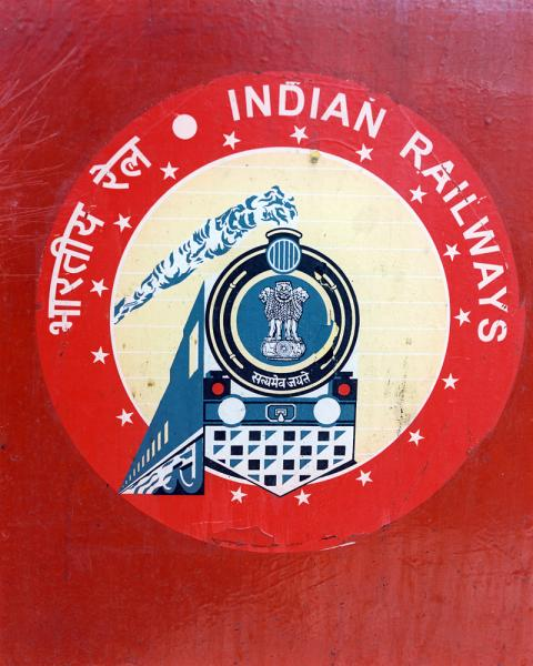 Signage of the India Railways Company, as seen from the Golden Chariot Train.