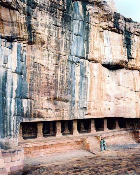 Walking outside of the cave temples in Badami, in Karnataka Province, India.