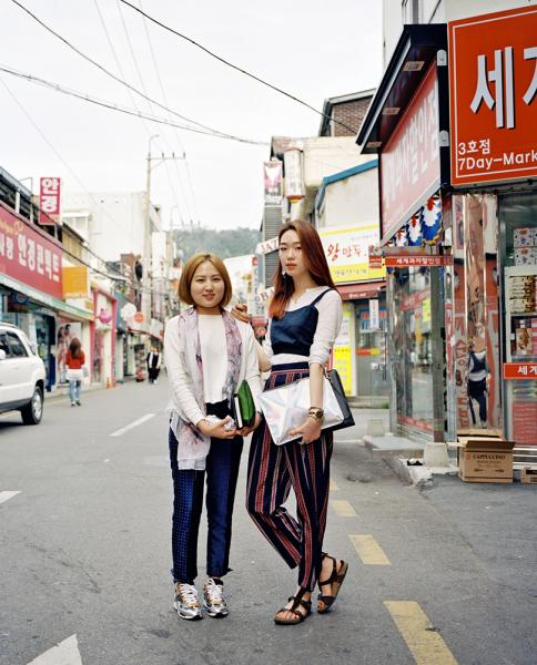 Chosun University and its surrounding areas, in Gwangju, South Korea. Here two young Korean women pose for a portrait.