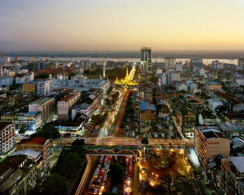 Yangon's Sule Pagoda at dusk as seen from Trader's Hotel (now the