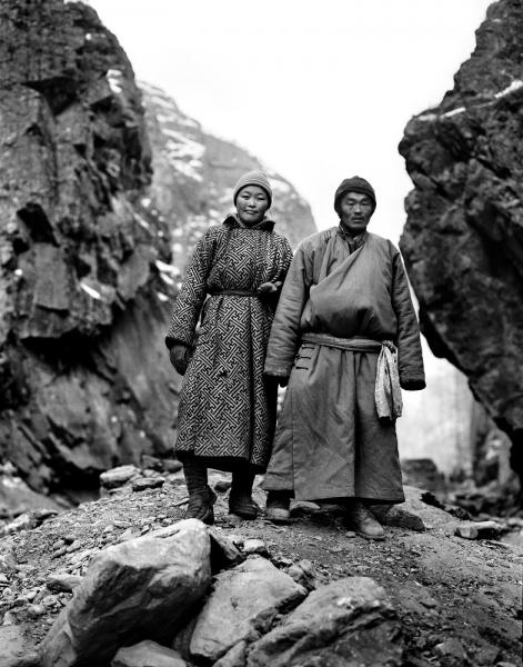 A young Mongolian couple dressed in traditional garb at an illegal gold mining camp ('Ninja Mining') in Khovsgol Province, Mongolia. Ninja Mining is the act of illegal gold mining, and the terminology is specific to Mongolia. It is a reference to the basins that the miners use to pan for gold - when slung over their backs they look like the Teenage Mutant Ninja Turtles.