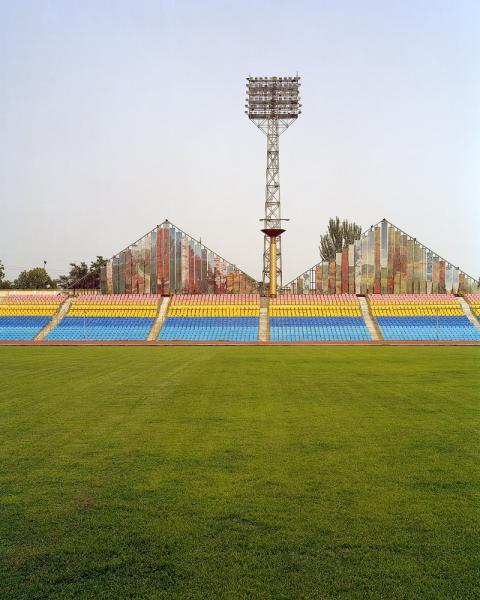 A stadium in Dushanbe, Tajikistan. Note the four seasons mural above the grandstand.