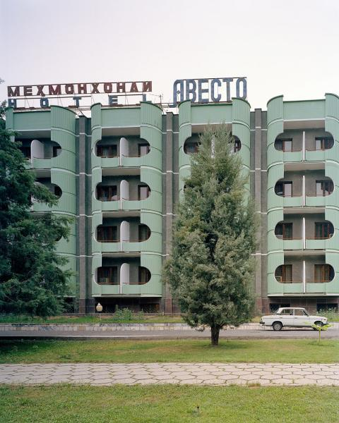 The Hotel Avesta in Dushanbe, Tajikistan complete with Russian Lada parked out front.
