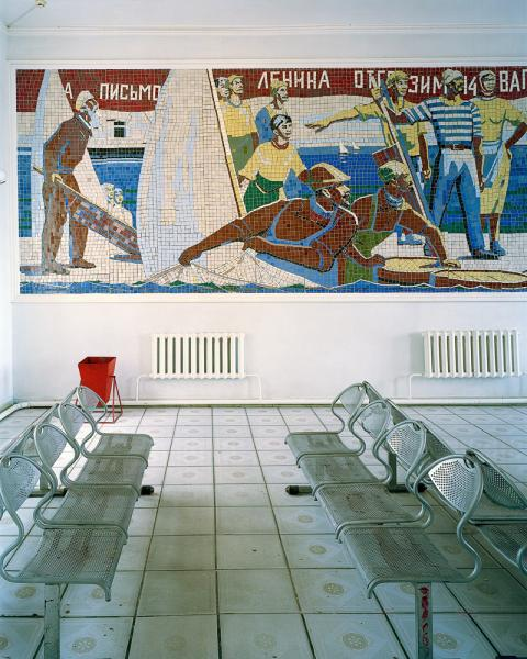 The train station in Aralsk, Kazakhstan. Note the mural depicts a scene from a bygone era with men pulling fish from the Aral Sea. The Aral Sea has all but disappeared as a result of intentional draining during the Soviet era to irrigate cotton crops in what is now Uzbekistan.