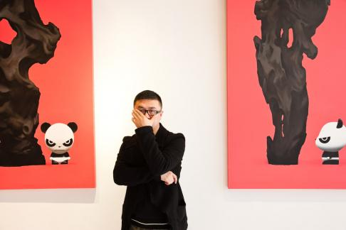 Renowned artist Jiji at his studio in Shanghai, China. Jiji is well-known for his depictions of angry pandas on canvas, sculptures, and through his clothing brand 'Hi Panda'. His t-shirts can be purchased online or through Shirt-Flag retailers in Shanghai, China.
