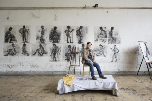 A portrait of Theson Nguyen (Nguyễn Thế Sơn) in a life-drawing studio at the Vietnam Fine Art University in Hanoi, Vietnam where he is a lecturer. Theson is an accomplished visual artist and photographer whose work has been exhibited worldwide and is held in museum and private collections (http://nguyentheson.com/).