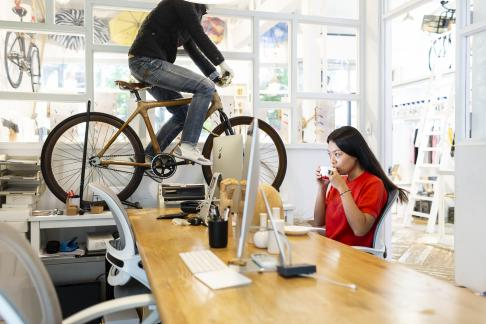 Yan Ran in the back office of Kate Wood, Shanghai. Kate Wood specializes in making bamboo bicycles and watches.