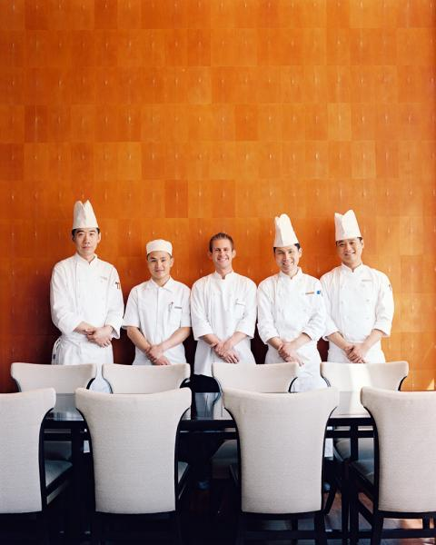 Chef Gerhard Passrugger and his team at Shanghai's Park Hyatt hotel, located in the Shanghai World Financial Center in Pudong's Lujiazui district. The building was constructed by Japan's Mori Corporation and towers 492m over the city.