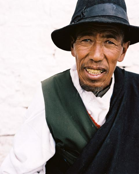 A portrait of a man outside the Potola Palace in Lhasa, Tibet, China.