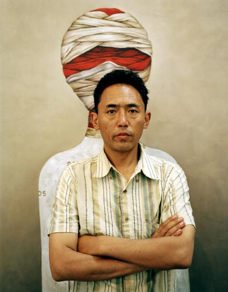 Norbu Tsering, contemporary Tibetan artist, in front of his piece