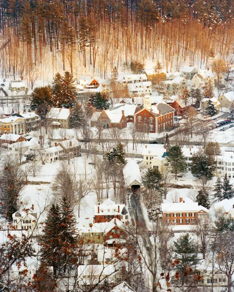 Scenic Woodstock Vermont at dusk, as seen from the top of Mount Tom shortly after a late Winter storm coated the town in snow.