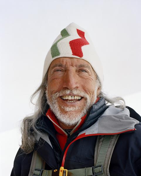 Wearing a stylized Italian flag-motif winter hat a skiier has a laugh after a pit-stop at Refugio Gran Sometta - an alpine rustic restaurant serving incredible home-style food. Tucked away high up on the mountain on the Italian side of Cervinia, near Zermatt, is The chef who started it, Luciano; who claims to be the first person to have cooked pasta on the mountain back in 1969. The dishes are all served on paper or plastic as there is no running water.