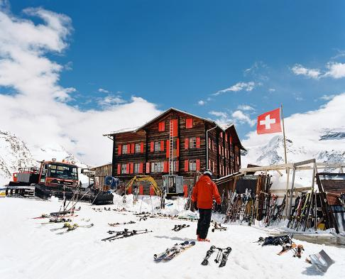 Located at 2616m, Fluhalp restaurant near Zermatt Switzlerand, has an immense outside deck for enjoying its incredible food and spectacular view of the Matterhorn on clear days. Seen here from the outside with skis lined up from the lunch crowd.